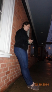 Jamie Armstrong texts friends while standing in front of the Centerville post office.