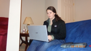 Armstrong sits in front of her computer reading over messages from her twitter account.