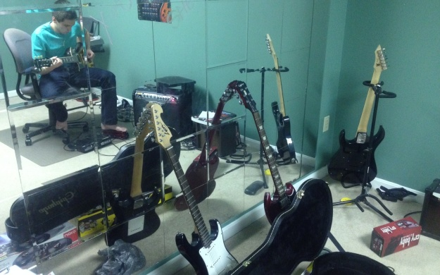 Anthony Katsakis plays the guitar to de-stress